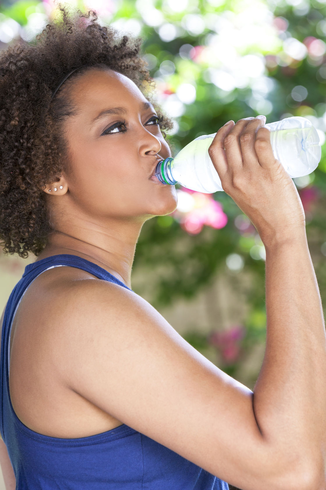 10 Steps To Detoxification.   Lady drinking water. https://www.wocdetox.com/body-detoxification.html